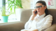 Businesswoman talking at mobile phone. video