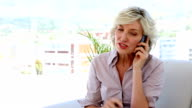 Businesswoman talking on the phone video