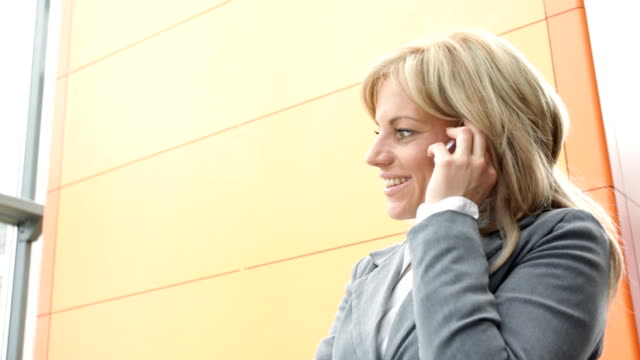 Businesswoman talking over cellphone,HD1080. video