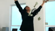 Businesswoman throwing money, slow motion video