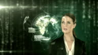 A businesswoman touching futuristic interface video
