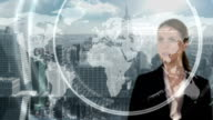 Businesswoman touching futuristic interface with city on background video