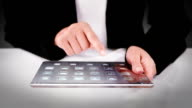 Businesswoman using a futuristic tablet. Financial. video