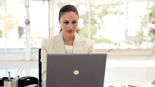 Businesswoman Using a Phone at the Office video