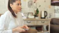 Businesswoman using a smart phone. video