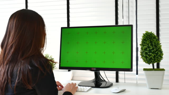 Businesswoman using Computer with Green screen, Chroma key video