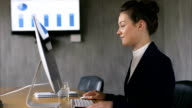 Businesswoman using desktop PC while attending call video