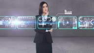 Businesswoman using digital interface screen with icons video