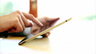 Businesswoman using digital tablet at desk video