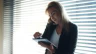 Businesswoman Using Digital Tablet In Office video