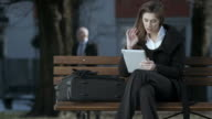 HD: Businesswoman Using Digital Tablet On Bus Station video