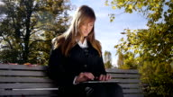 DOLLY: Businesswoman using digital tablet outdoors video
