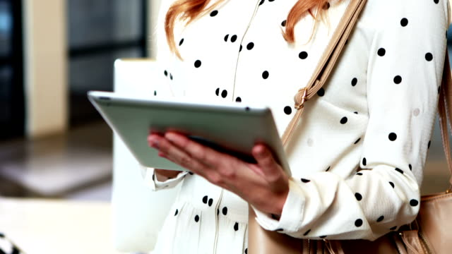 Businesswoman using digital tablet video