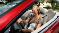 Businesswoman using hands-free communication technology video