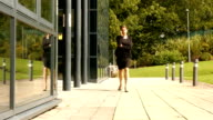 Businesswoman using her phone outside video