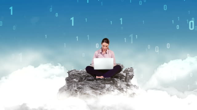 Businesswoman using laptop in the clouds video