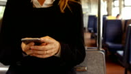 Businesswoman using phone on the train video