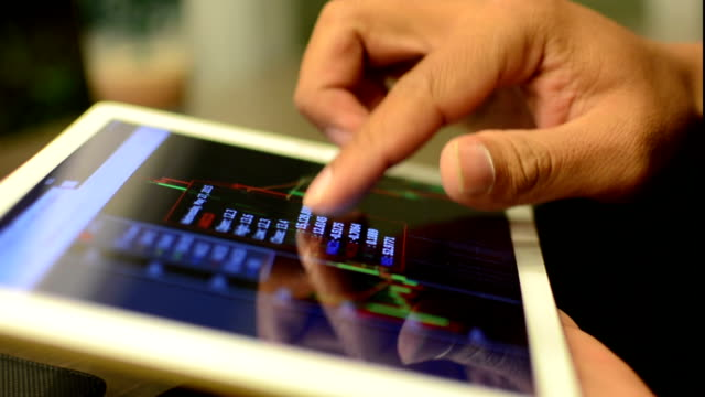 Businesswoman using Tablet analysis stock video