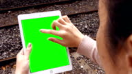 Businesswoman using tablet on train platform video