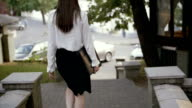 Businesswoman walking in the old city. slow mo video
