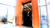 Businesswoman Walking Past Elevator in Modern Office Building. video