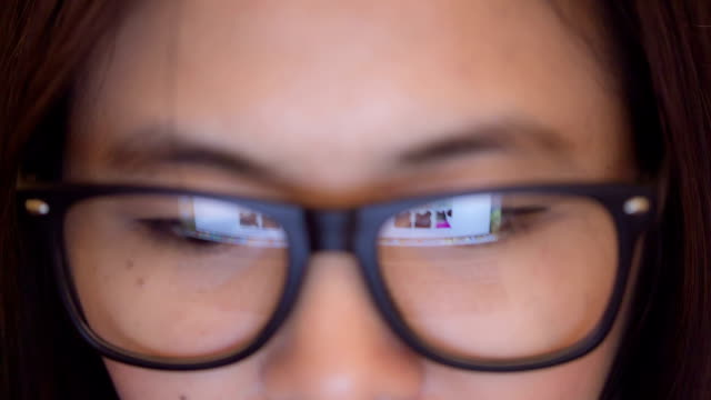 Businesswoman watching Information of laptop computer video