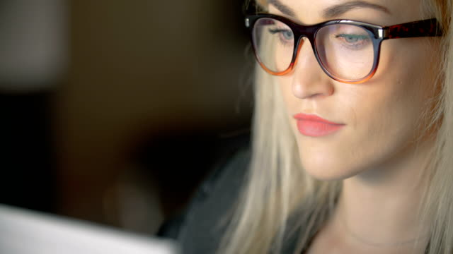 Businesswoman Wearing Eyeglasses While Using Laptop In Office video