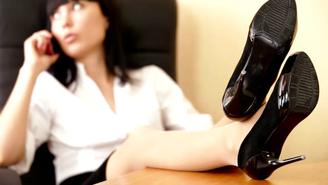 Businesswoman With Feet On Table video