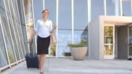 Businesswoman With Suitcase Going On Trip Shot On R3D video
