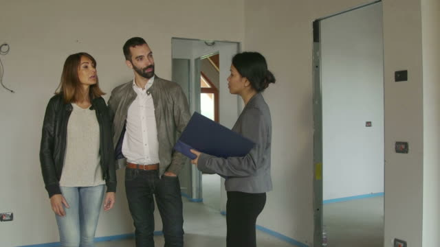 Businesswoman Woman Working As Architect Clients Customers In New Apartment video