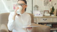 Businesswoman working and enjoying a good coffee. video