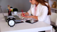 Businesswoman working at desk in office video
