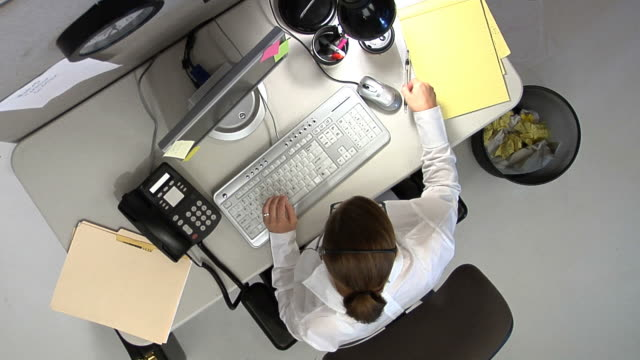 Businesswoman working fast video