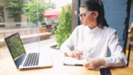 Businesswoman working in a coffee shop. video