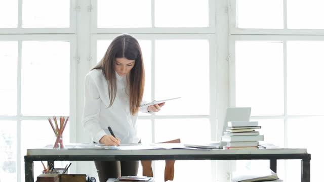 Businesswoman working in her office. video