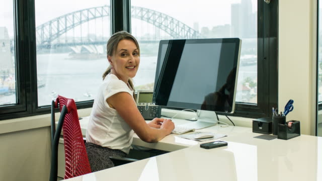 Businesswoman working in the office video