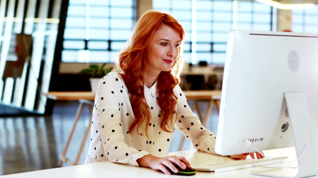 Businesswoman working on computer video