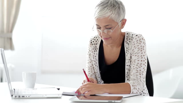 Businesswoman working on digital tablet video
