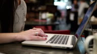 Businesswoman working on laptop in cafe video