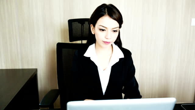Businesswoman working with Computer laptop video