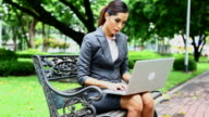 HD: Businesswoman working with laptop outdoor. video