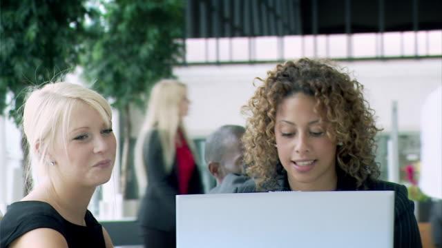 Businesswomen discussing office plans video