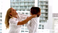 Businesswomen getting physical in a fight video