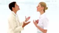 Businesswomen having a heated debate video