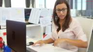 Businesswomen Working At Desks In Modern Open Plan Office video