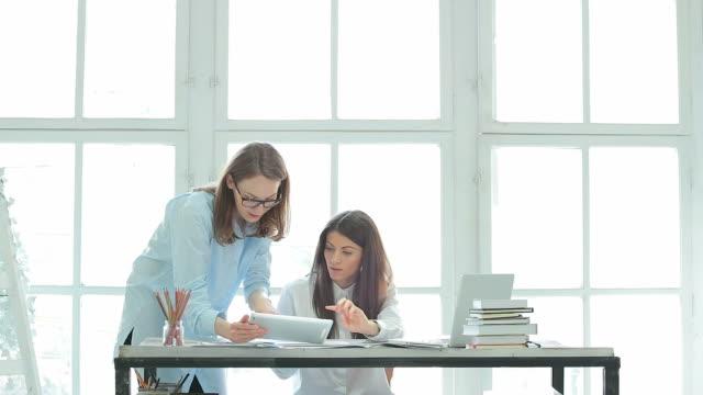 Businesswomen working in their office. video