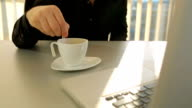 Bussines mixing sugar in coffee cup video