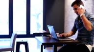 Busy businessman working in restaurant video
