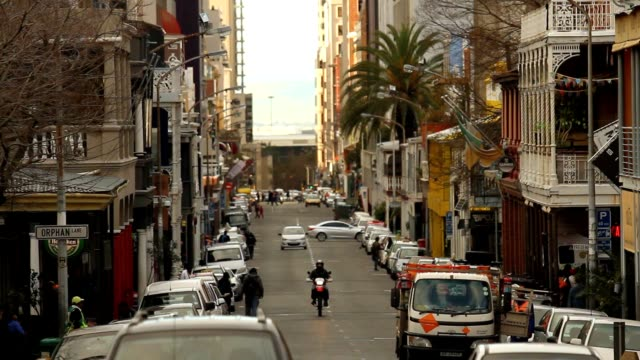 Busy Cape Town street, late afternoon, filled with cars, pubs and people video