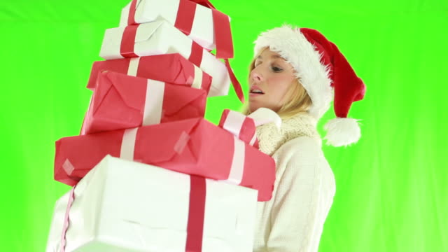 Busy christmas shopping-Woman falling with presents video